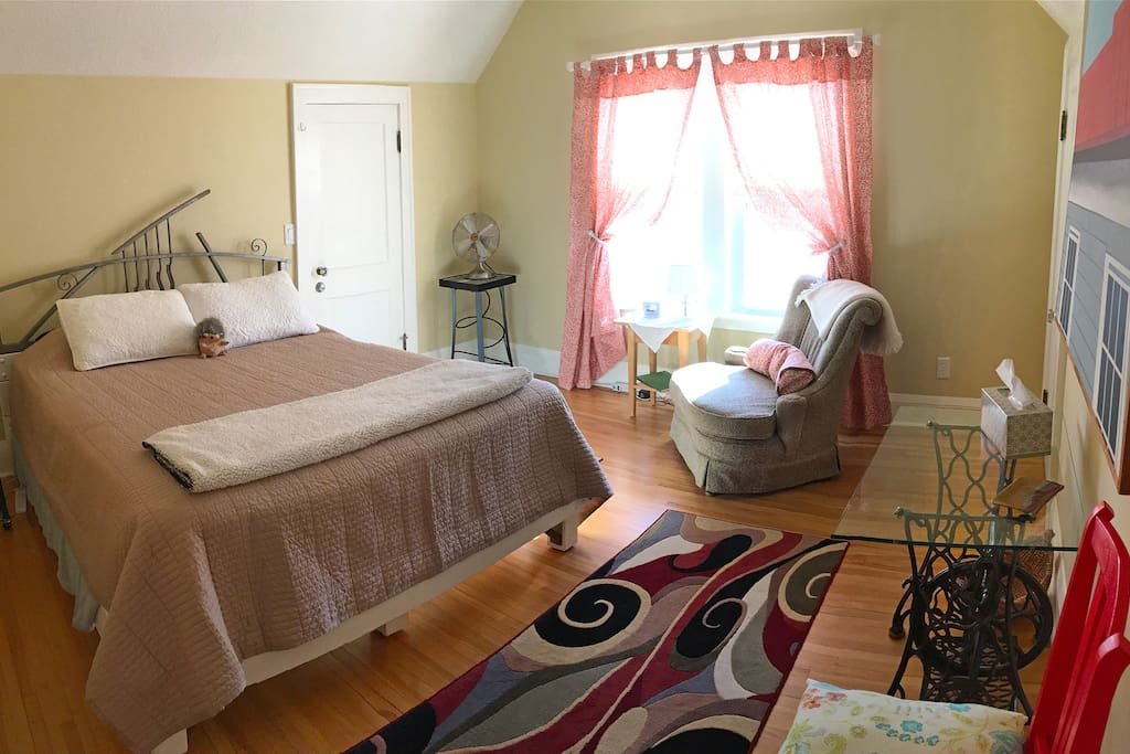 The cozy east bedroom has a queen bed with a walk-in closet.