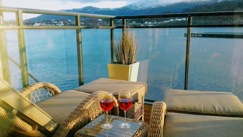 Balcony with comfortable chairs adjustable for sitting or lying down. Enjoy the ocean and alps:)