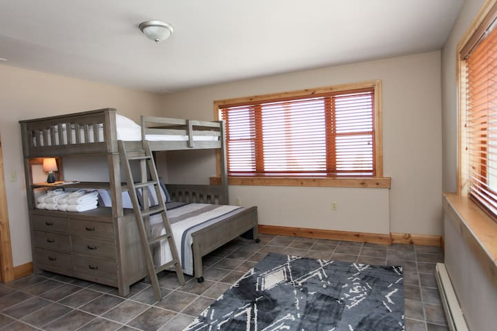 """Lower level """"bunk room"""" with 2 full size beds.  Bunk bed can be rearranged to have 2 single beds."""