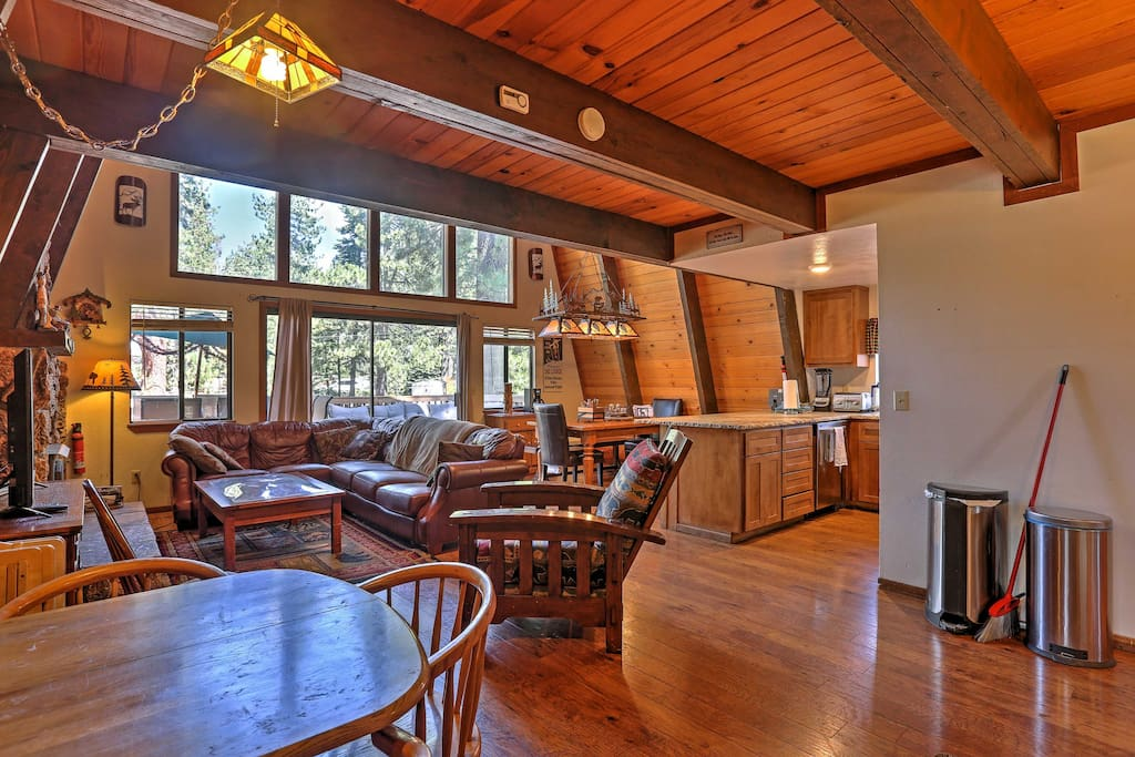 The cabin features an open rustic layout in the living area.