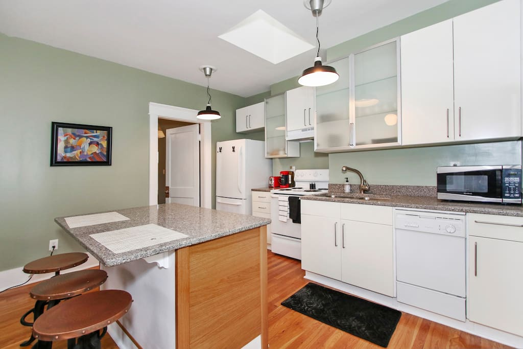 Prepare a meal on spacious granite countertops