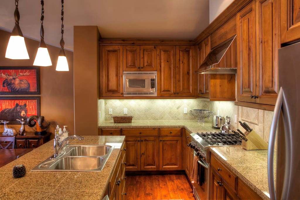 The professionally outfitted kitchen with solid granite countertops
