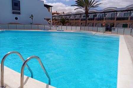 Appartement Relax devant la piscine