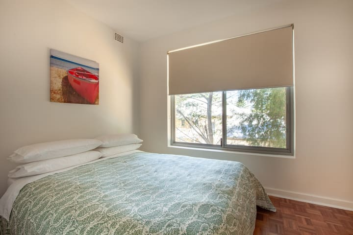 Bedroom 2 is smaller with a double bed, clothes hanging. Behind the door you will find the ironing board, a clothes airing rack and a glide mop/broom.