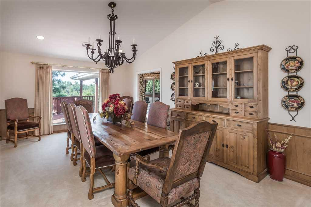 Elegant Dining - This elegant dining table with room for 8 is perfect for indulging in a family feast!