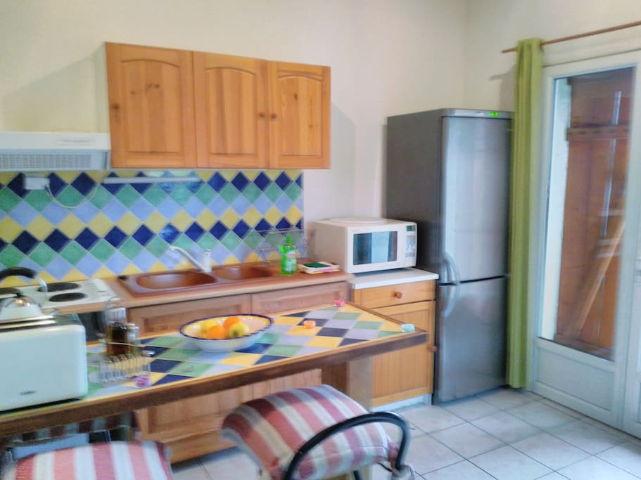 Well equipped kitchen with 4 ring hob, combination oven/mricowave full size fridge/freezer and  breakfast bar with stools