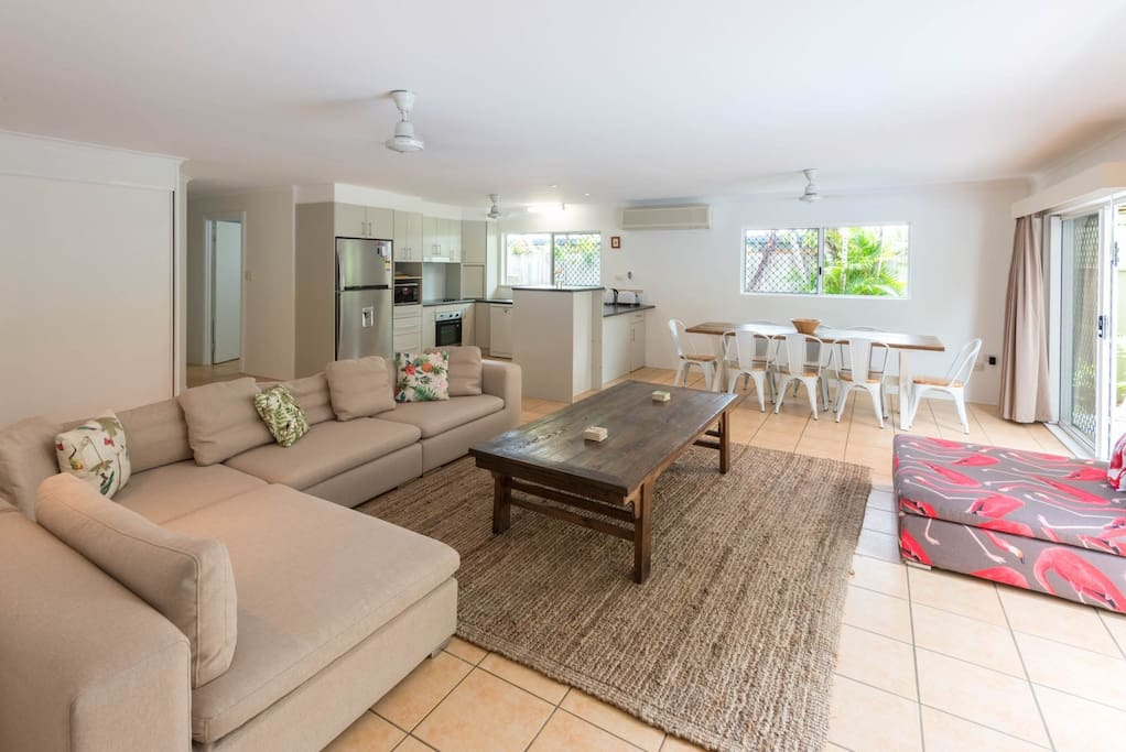 Open plan living, beautifully furnished, overlooking pool, lawn and rainforest