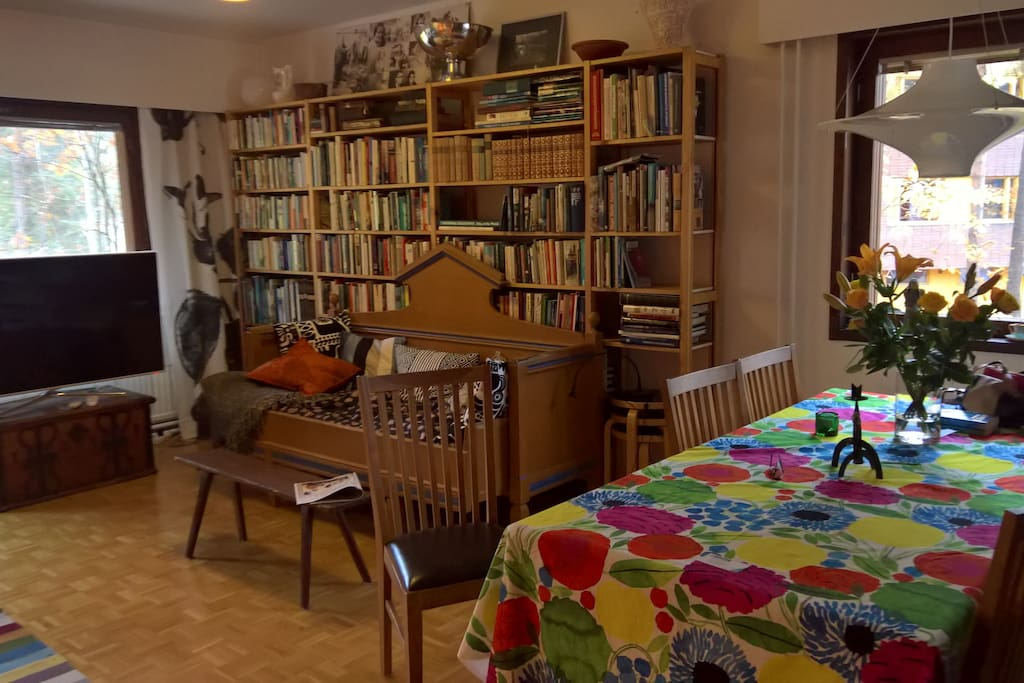 Living room- dining table with six chairs; TV. Love books-- plenty of them in three languages!