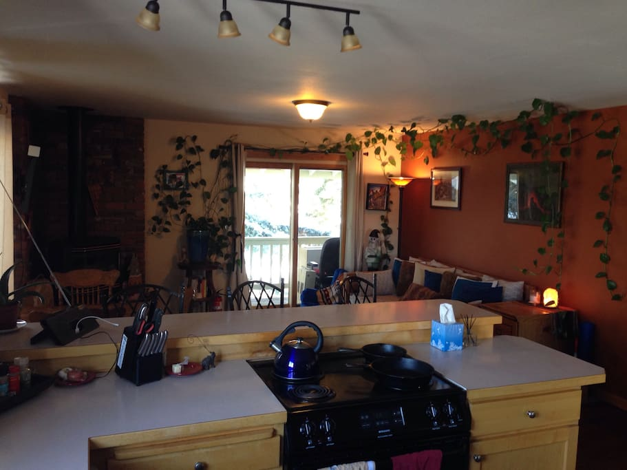 Open kitchen layout, balcony w/ view out to soccer field.