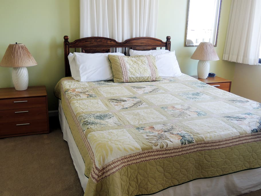 Comfortable king size bed with extra pillows