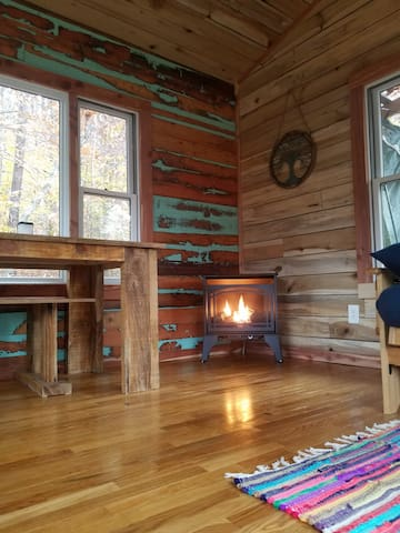 Stay warm and cozy in the winter with the propane fireplace! This fireplace can get hot enough to melt paint. You won't be cold and may even have to crack open a window!