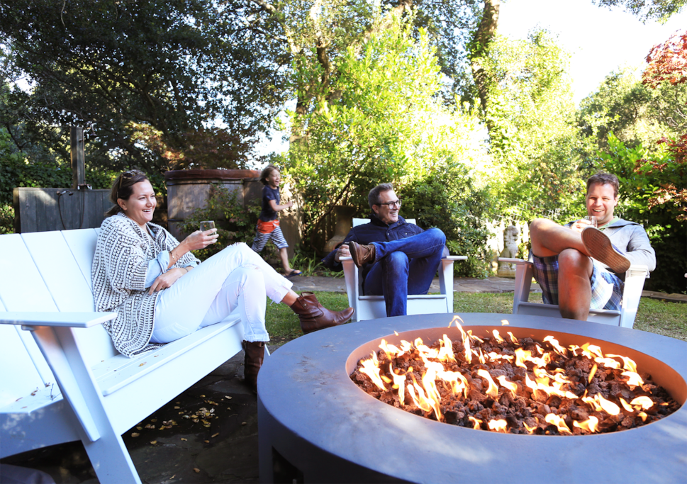 Gather with friends and family around the firepit while the kids enjoy the giant treehouse, endless rides on the zip line, or a warm dip in our Redwood hot tub.