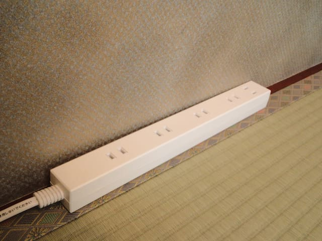 Power strip in guest room.