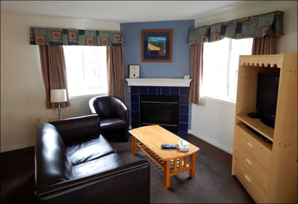 This 2 bedroom upper apartment features a cozy living area with a fireplace