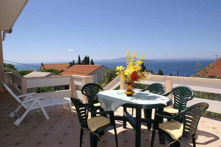 Two bedroom apartment with terrace and sea view Lun (Pag) (A-4062-b)