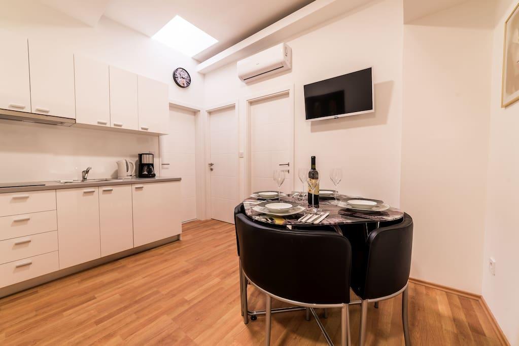 Kitchen. Kitchen Table. TV
