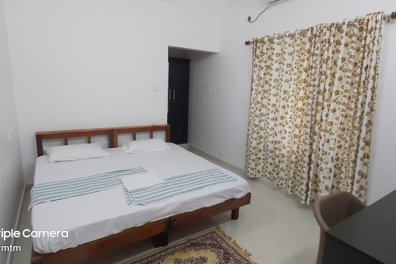 Bedroom with TV, Workspace etc.
