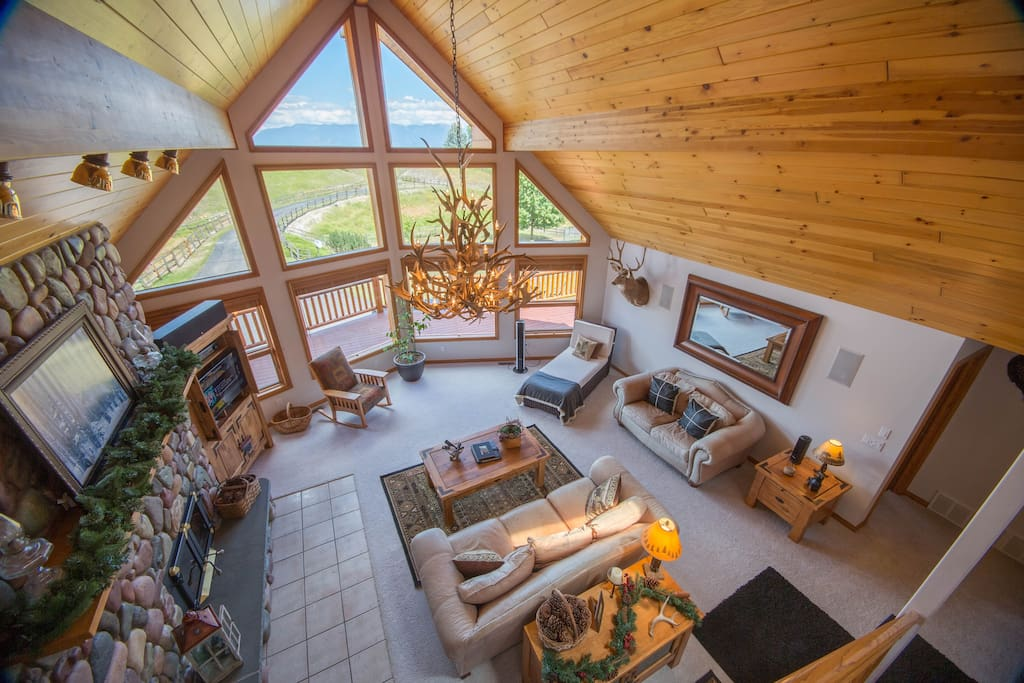 Wide open living room with tv, comfortable couches, views into Glacier park and of Big Mountain
