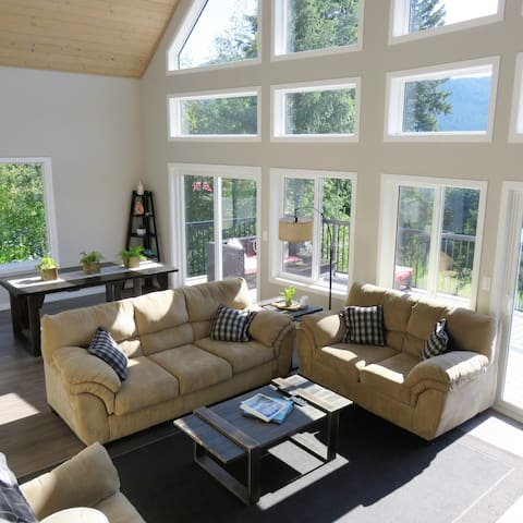 View of open living area, looking down from stairs that lead to loft master bedroom.