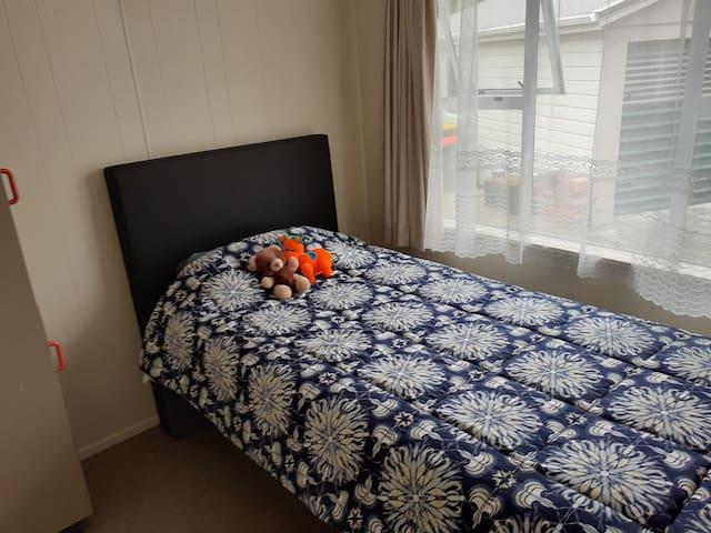 Single bedroom off dining room