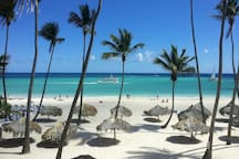 Our private beach with personal loungers and parasol