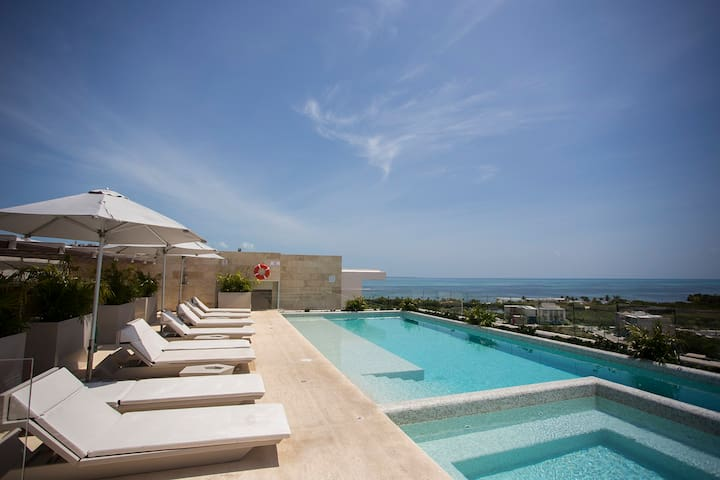 Exclusive apartment- Rooftop pool -near the beach
