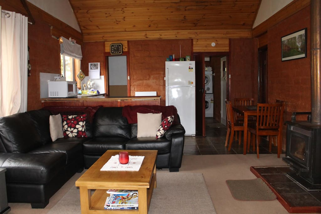 Lounge/dining/kitchen with cosy wood fire, board games, tv, dvd player