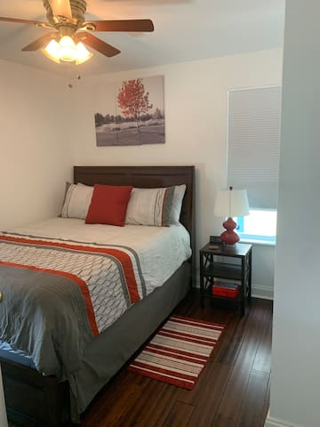 Queen size bed with lamp and nighstand
