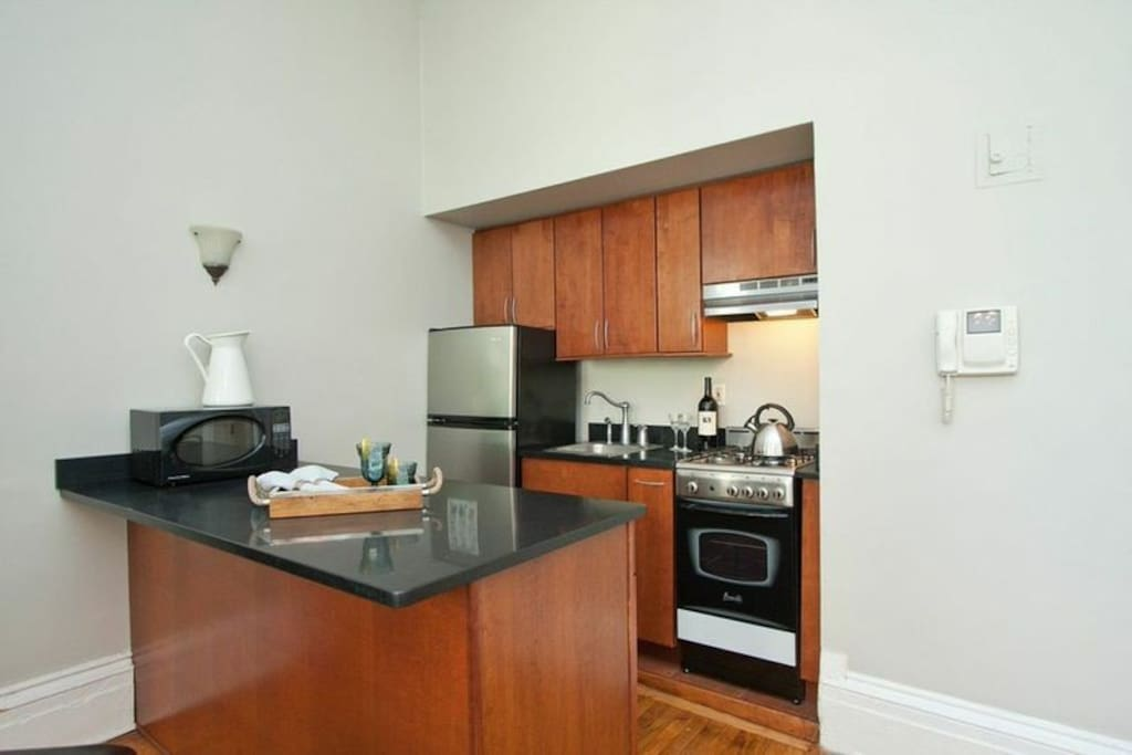 Open kitchen with washer/dryer