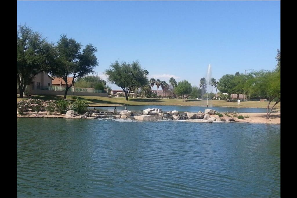 Beautiful park with walking path, tennis court, playground, basketball court one block away.