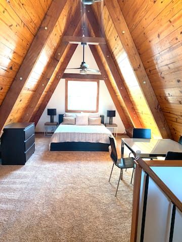 2nd Loft Bedroom with a queen sized bed, twin pull out love seat sofa, and a table for playing cards or puzzles.