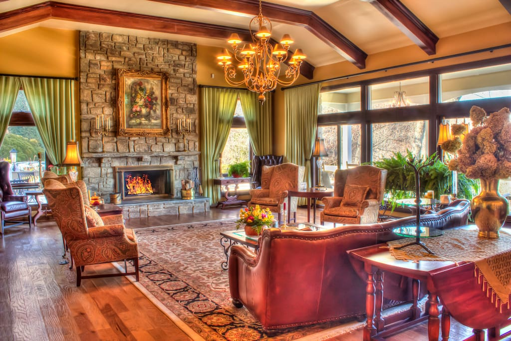 Spacious living room with bar and fireplace.