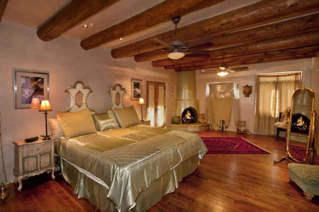 The master bedroom is fit for royalty with a specially designed bed and wood-burning kiva fireplace.