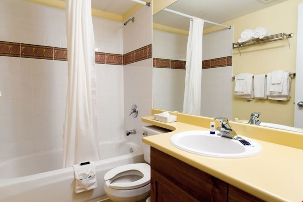 There are two bathrooms, both with shower and tub combination.