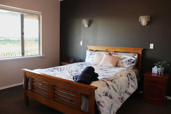 Master Bedroom with walk-in closet and en suite bathroom and toilet
