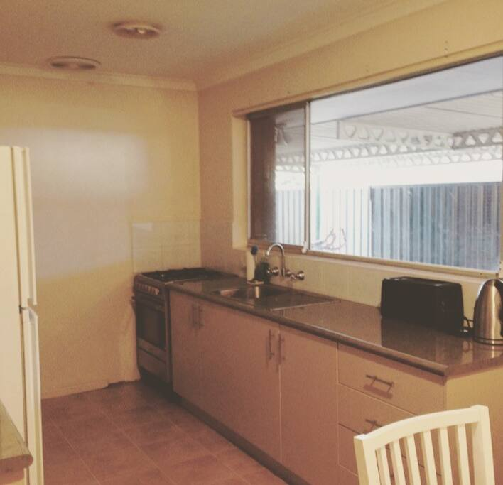 Kitchen with outlook onto rear alfresco