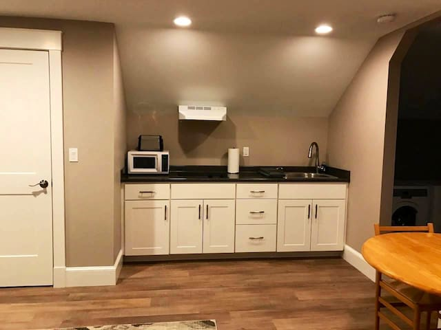 Kitchenette with table and pantry closet