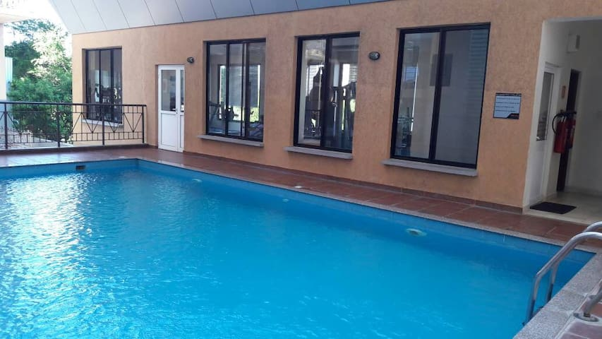 Swimming area located within the apartment compound,adjacent to Gym area