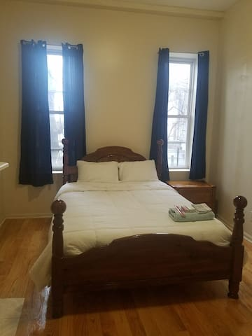Comfortable Queen Size bed with view of backyard and plenty of sunlight