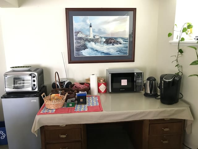 The breakfast nook includes a new Keurig coffee maker, microwave, toaster oven, small refrigerator, and hot pot.