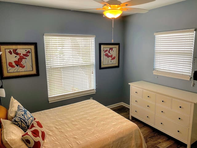 Separate bedroom with queen bed, dresser, and closet