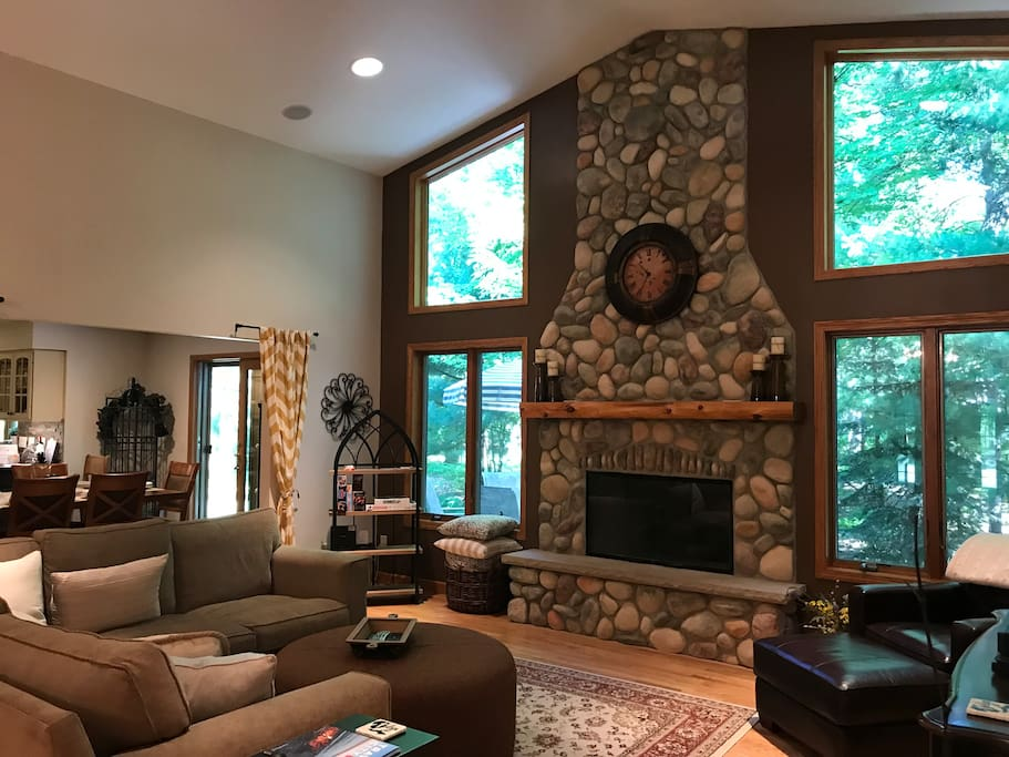 Cathedral ceiling in Great Room, open floor plan flows into large Kitchen.  Gas fireplace.  Natural sunlight.  Private yard backs to wooded scenery.  Relaxing!