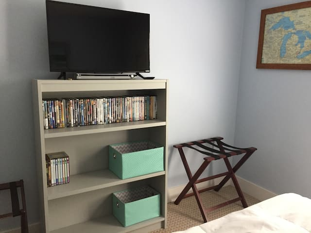 The room includes a TV and DVD player with a library of 50+ titles.