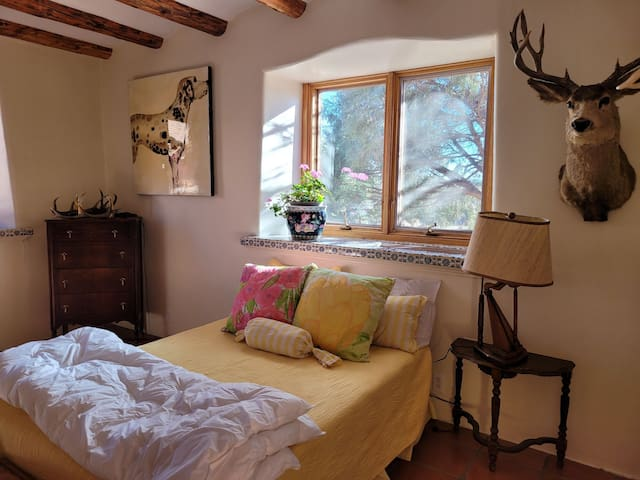 Double bed in bedroom with gorgous kiva fireplace
