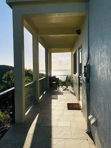 The walkway to your studio, ocean views and private dining area outside