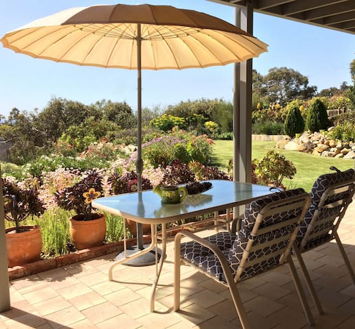 Sheltered outdoor relaxing area overlooking the garden and city view.