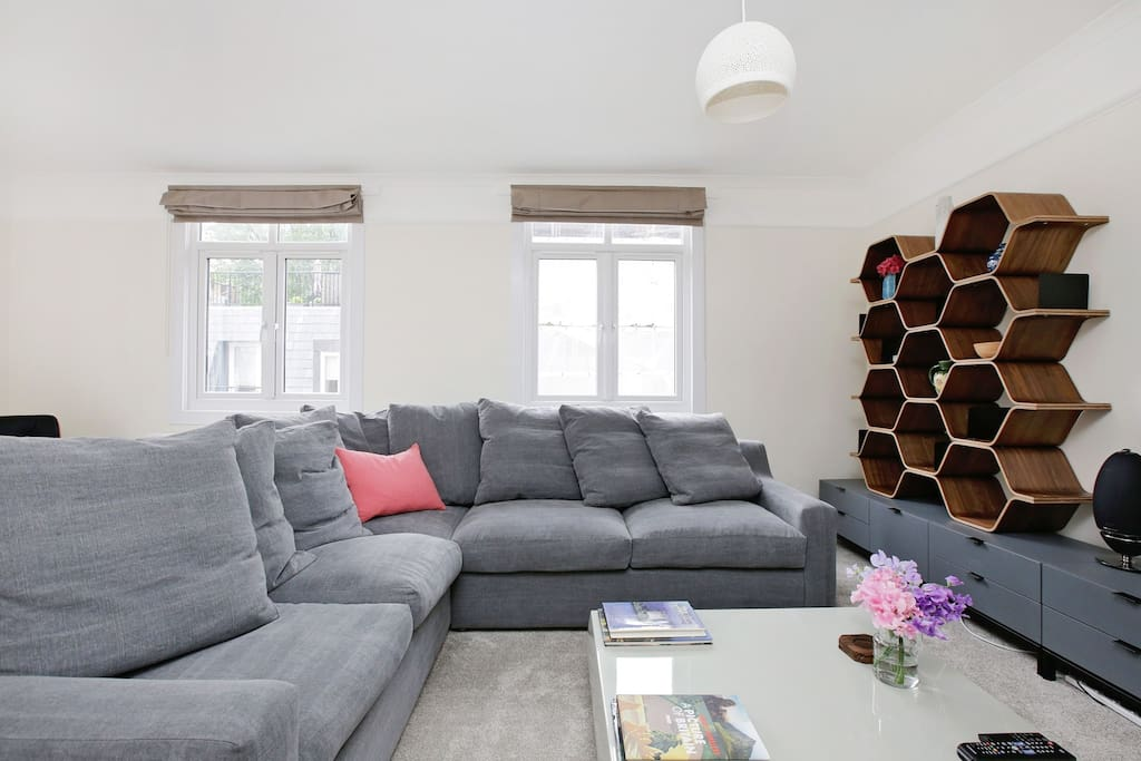 Living area featuring plush over-sized L-shaped sofa