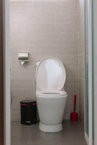 Upstairs Bathroom: Bedroom 1 & 2 share a common bathroom with individual access doors.