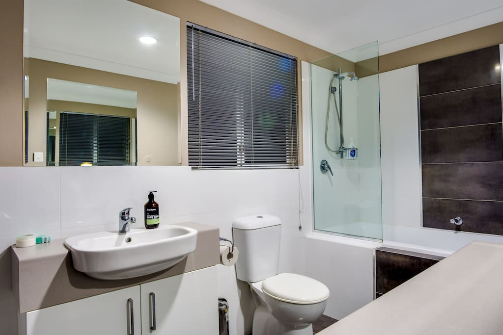 Beautiful ensuite with an ocean view from the shower/bath.