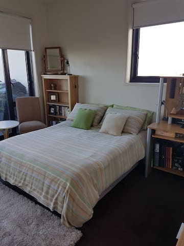 Bedroom with very comfortable double bed. Sliding glass door  opening  to large outdoor patio.